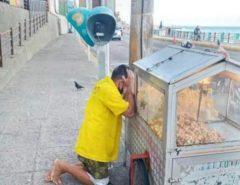 EFEITOS DO GOVERNO FÁTIMA: Foto de vendedor de pipoca desolado em Natal viraliza após novas restrições